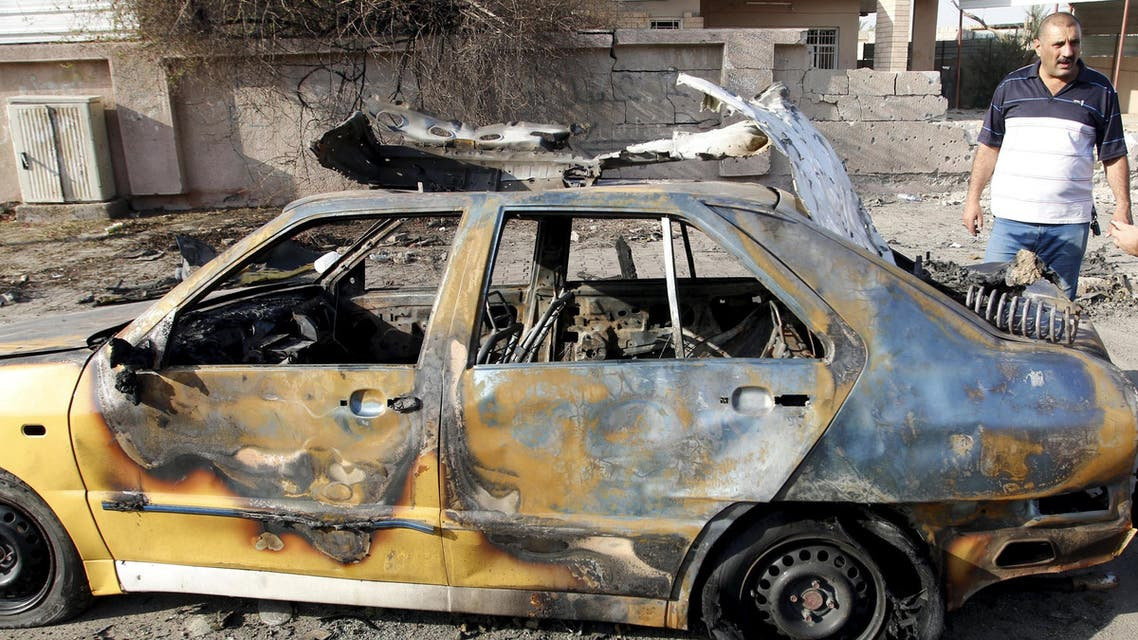 A destroyed vehicle is seen at the site of car bomb attack in Baghdad. (File photo: Reuters)
