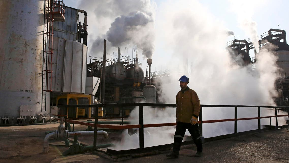 In Monday, Dec. 22, 2014 photo, an Iranian oil worker walks at Tehran's oil refinery south of the capital in Iran. (AP)