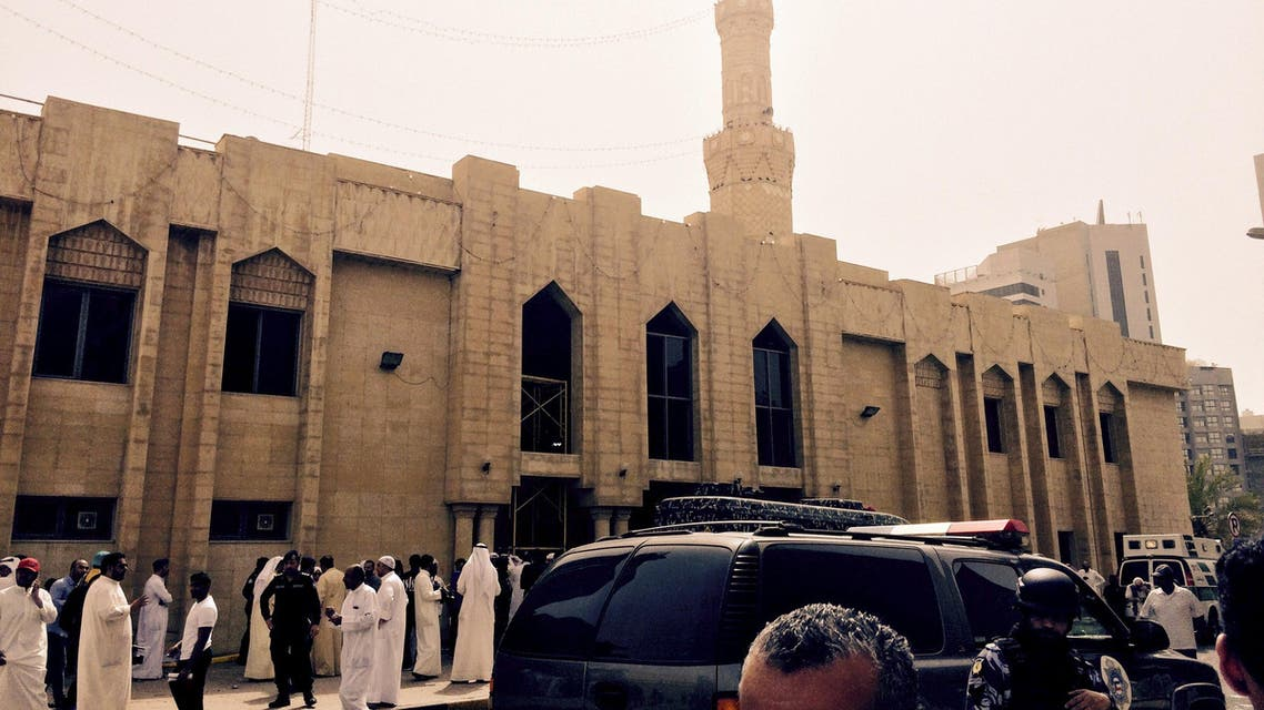 Police control the crowd in front of the Imam Sadiq Mosque after a bomb explosion, in the Al Sawaber area of Kuwait City. (Reuters)