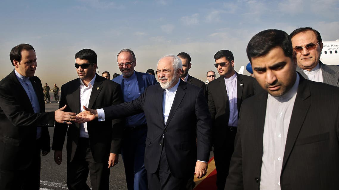 APTOPIX Mideast Iran Nuclear Talks Download Comp Cancel Apply Back to search results 2 of 1,513 results APTOPIX Mideast Iran Nuclear Talks      Overview     Download now  Iran's Foreign Minister Mohammad Javad Zarif, who is also Iran's top nuclear negotiator, center, shakes hands with an official upon arrival at the Mehrabad airport in Tehran, Iran, Wednesday, July 15, 2015. Zarif and his entourage returned to Tehran on Wednesday morning, a day after Iran and the West reached a historic nuclear deal. (AP Photo/Ebrahim Noroozi)
