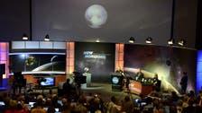 U.S. spacecraft survives close encounter with Pluto