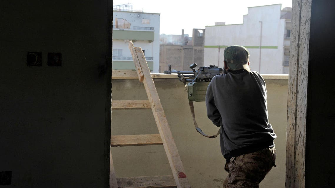 In this Wednesday, Oct. 29, 2014 photo, a Libyan military solider aims his weapon during clashes with Islamic militias in Benghazi, Libya. AP