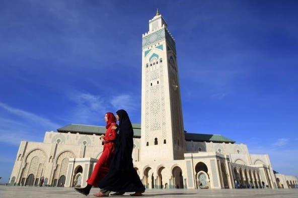Moroccan women walk past the Hassan II mosque in Casablanca February 24, 2011.  REUTERS