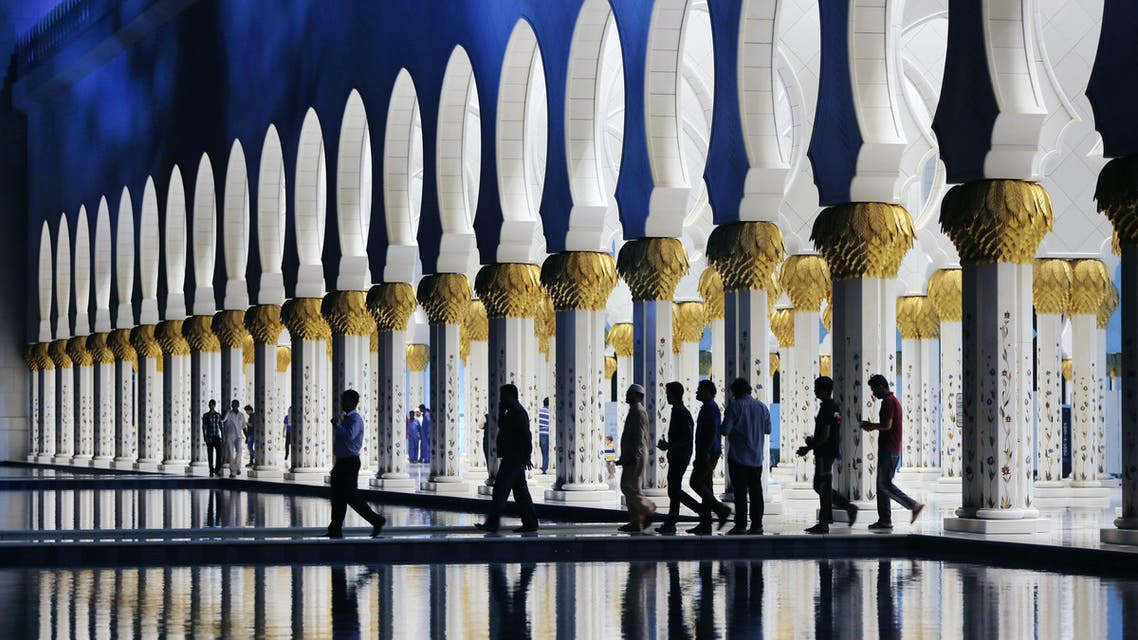 """Muslims leave the Sheikh Zayed Grand Mosque after praying """"Taraweeh,"""" the night prayer practiced during the month of Ramadan in Abu Dhabi AP"""