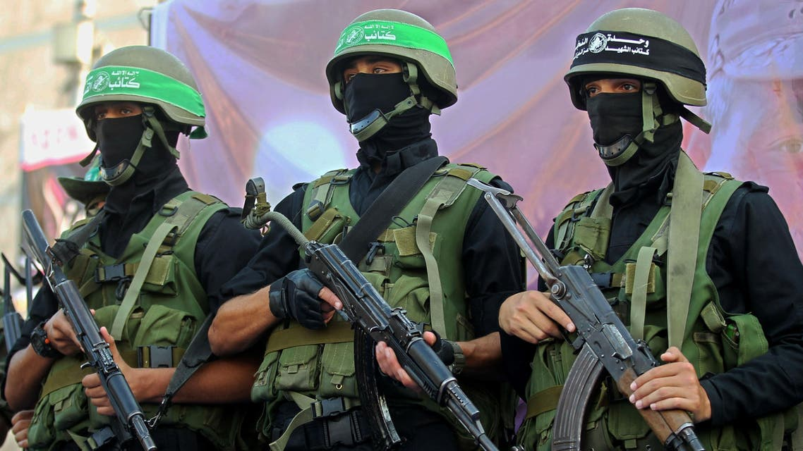 Palestinian members of the al-Qassam Brigades, the armed wing of the Hamas movement, take part in an anti-Israel parade on July 13, 2015 in Rafah, in the southern Gaza Strip, on the first anniversary of the 50-day war between Israel and Hamas' militants in the summer of 2014. AFP
