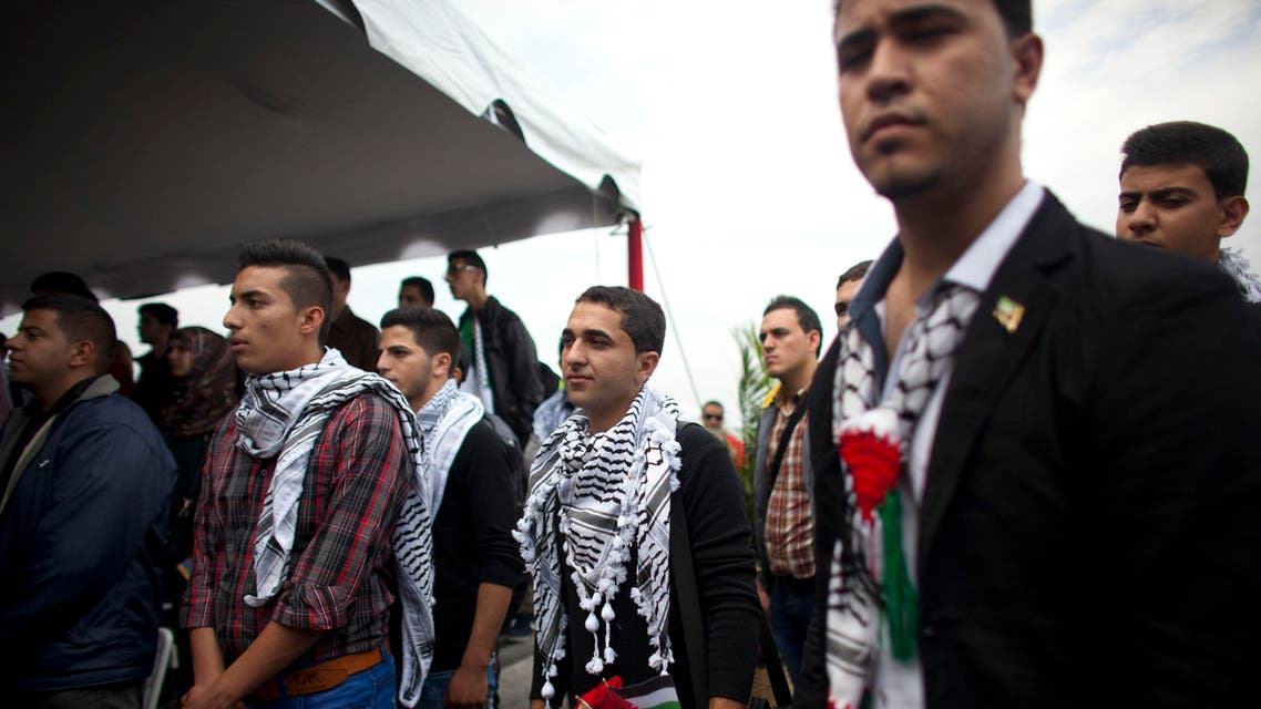 In this Nov. 6, 2014 file photo, Palestinian students attend a welcome ceremony at the Simon Bolivar airport in Maiquetia, Venezuela. AP