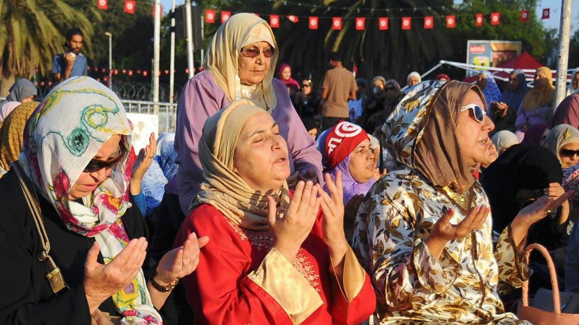 Tunisian women pray near the Zitouna mosque for the Eid al-Fitr prayer, Thursday, Aug.8, 2013 in Tunis. AP