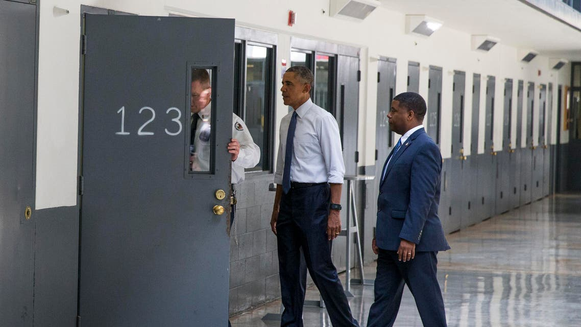 President Barack Obama is led on a tour by Bureau of Prisons Director Charles Samuels, right, and correctional officer Ronald Warlick during a visit to the El Reno Federal Correctional Institution in El Reno, Okla., Thursday, July 16, 2015. AP