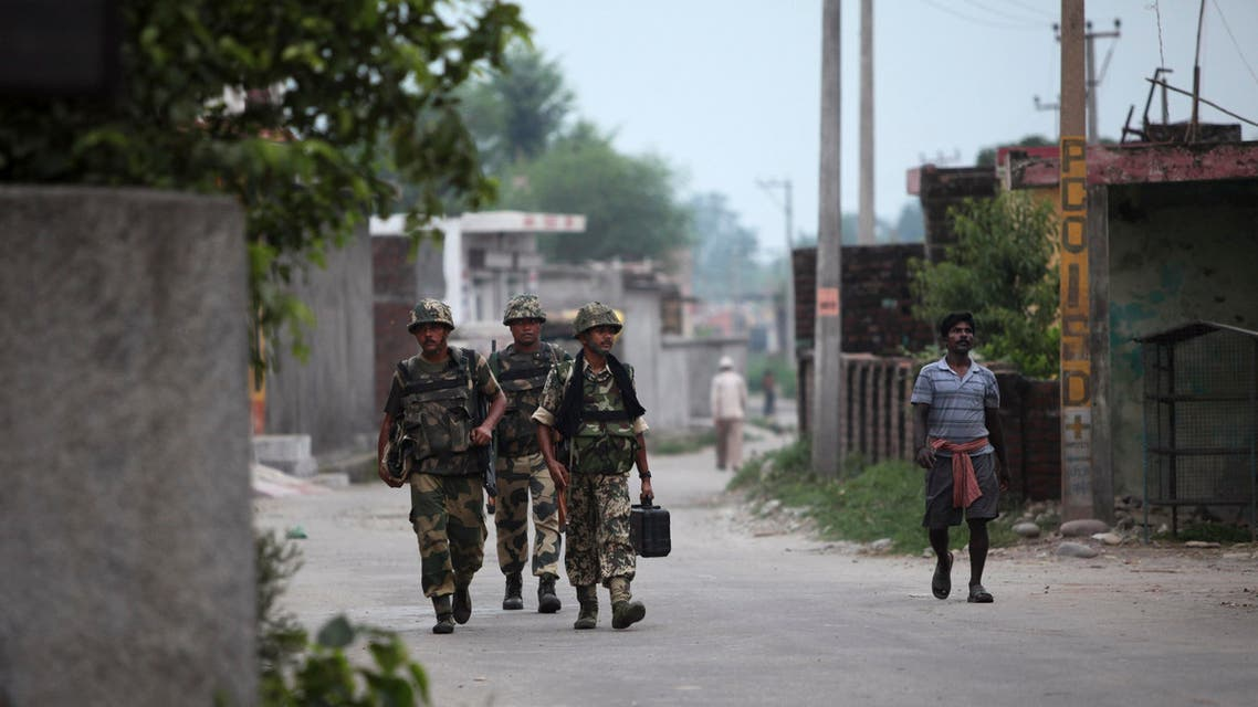 Indian Border Security Force (BSF) soldiers patrol at Garkhal village, 30 kilometers (19 miles) from Jammu, India, Wednesday, July 15, 2015. AP