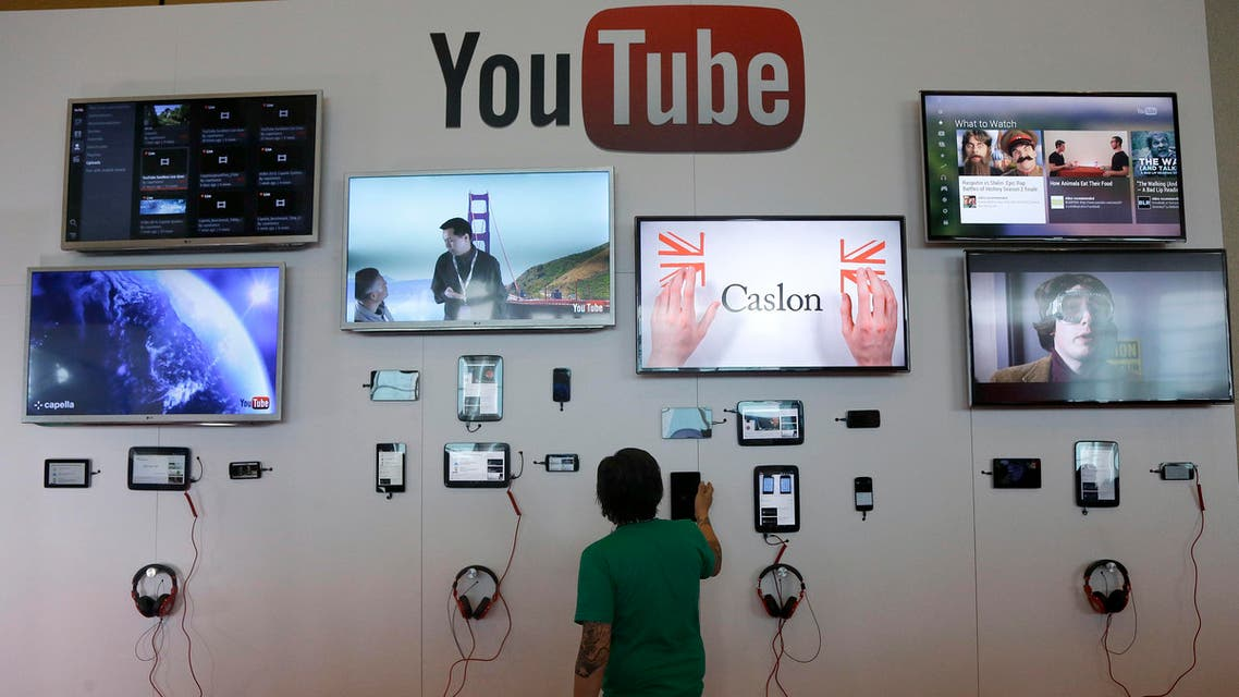 A man looks at a device a the YouTube booth at Google I/O 2013 in San Francisco. (File: AP)