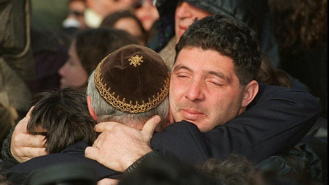 Three members of the Argentine Jewish community embrace during a ceremony Tuesday, July 18, 1995 on the first anniversary of the terrorist attack that destroyed Buenos Aires' Jewish Community Center, killing almost 100 people. One year after the worst peacetime attack on Jews outside Israel, almost 3,000 people gathered in silence opposite the bombed site of what was once a thriving cultural center. (AP Photo/Juan Jose Rojas,La NACION)