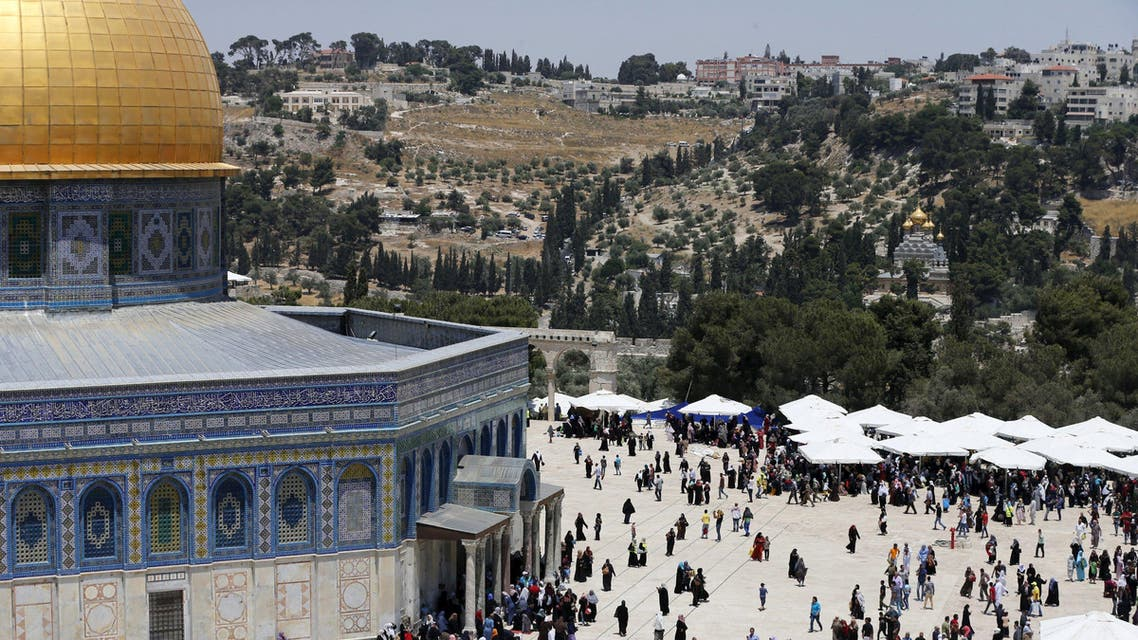 Palestinians walk near the Dome of the Rock on the third Friday of the holy month of Ramadan at the compound known to Muslims as the Noble Sanctuary and to Jews as Temple Mount, in Jerusalem's Old City July 3, 2015. REUTERS