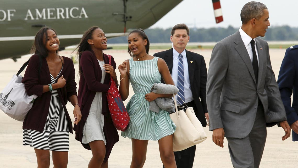 U.S. President Barack Obama and daughter Sasha (R), along with two of Sasha's friends, board Air Force One as they depart Joint Base Andrews in Washington July 17, 2015. (Reuters)