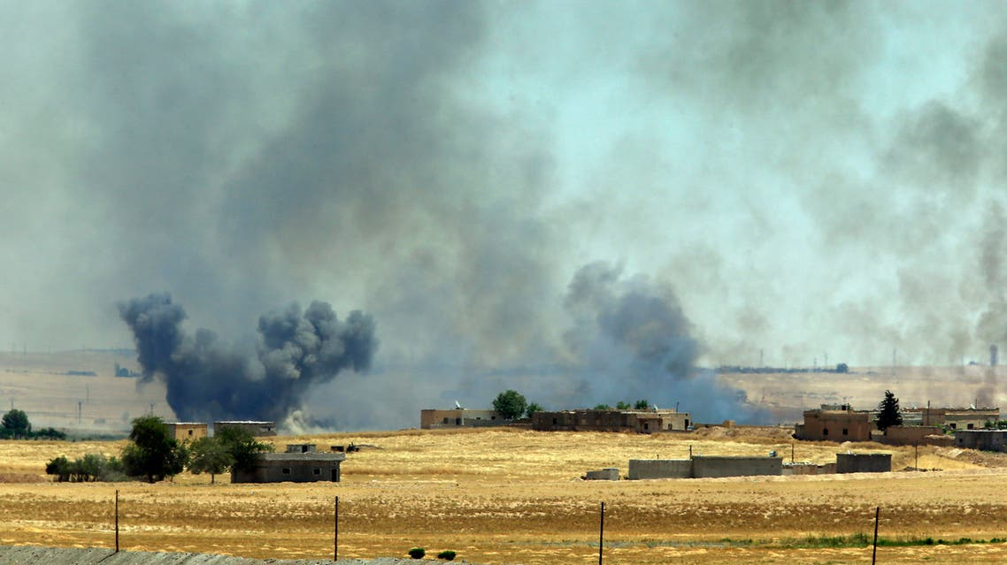 Syrian Kurdish fighters closed in on the outskirts of a strategic ISIS-held town on the Turkish border in June.a (AP)