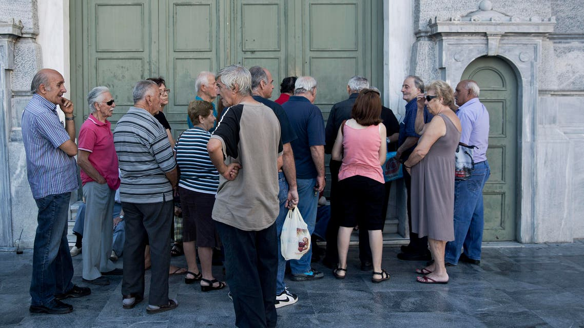 Pensioners wait for the opening of the national bank of Greece to withdraw a maximum of 120 euros ($134) for the week in central Athens, on Friday, July 17, 2015. (AP)