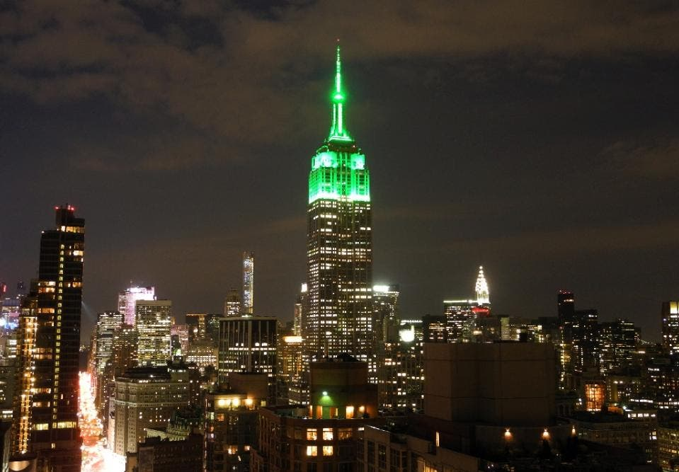 The Empire State Building glows green on July 17, 2015 in New York City to celebrate the Eid al-Fitr holiday that marks the end of Ramadan (AFP)