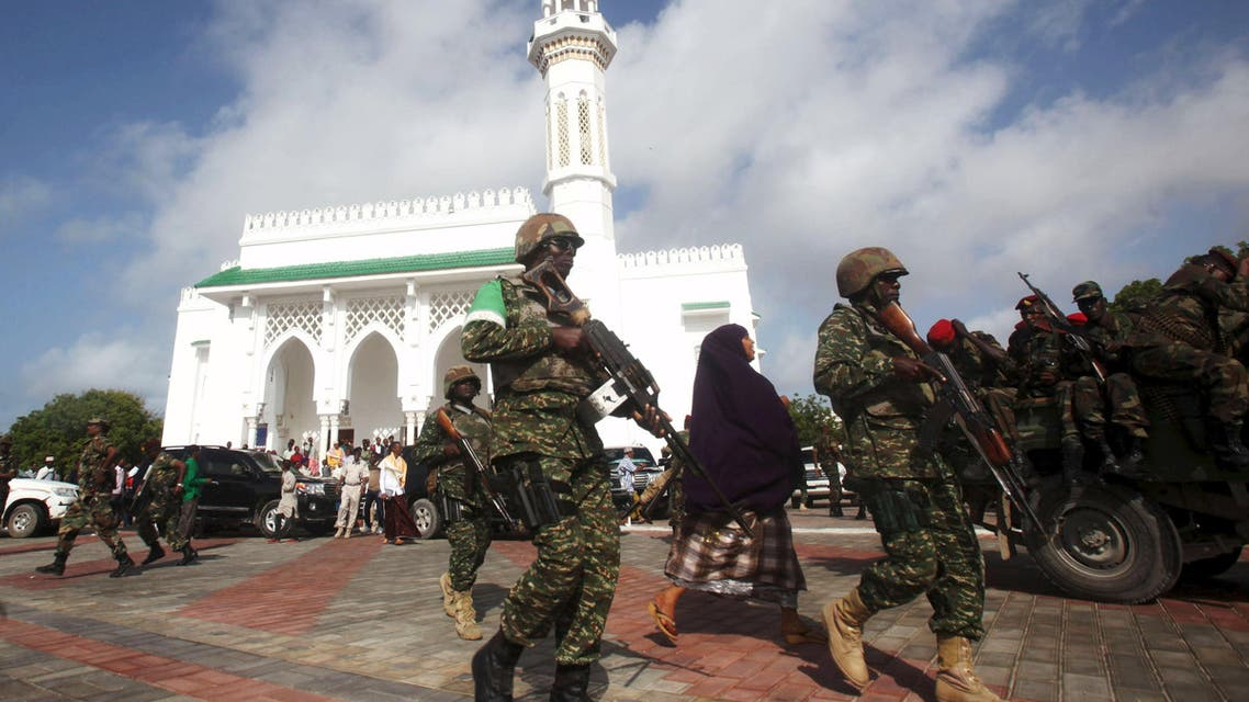 Soldiers serving in the African Union Mission in Somalia (AMISOM) patrol outside a Mosque during Eid al-Fitr prayers. (File: Reuters)