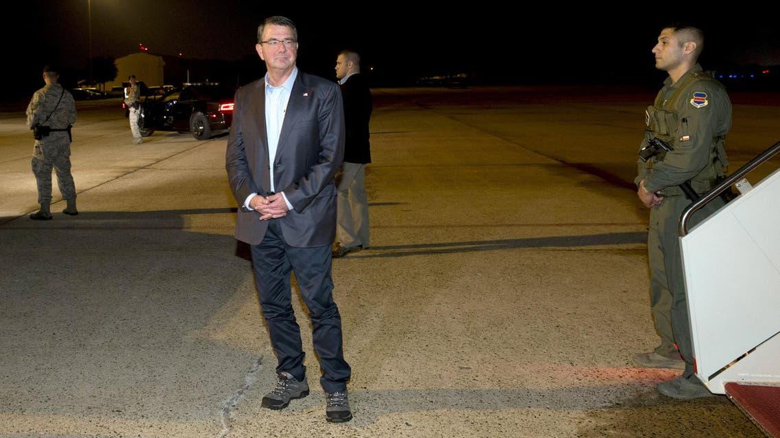 U.S. Defense Secretary Ash Carter pauses on the tarmac as he boards his plane en route to Tel Aviv, Israel. (Reuters)