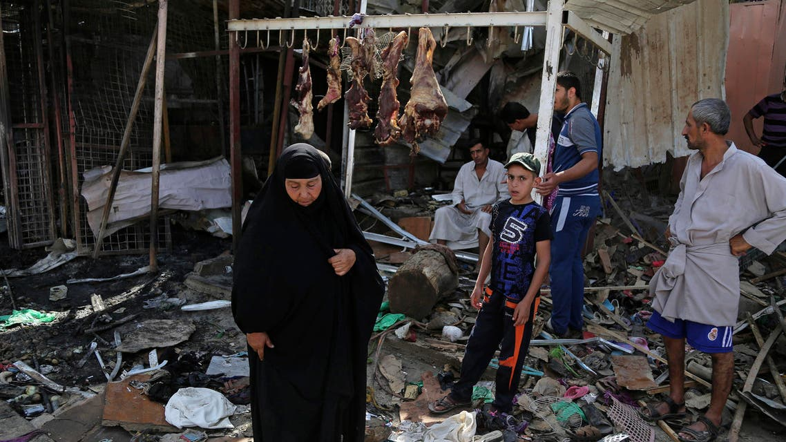Civilians inspect the scene of a deadly Friday night suicide car bombing at a busy market in Khan Beni Saad, about 20 miles (30 kilometers) northeast of Baghdad, Iraq, Saturday, July 18, 2015. The attack by the Islamic State group on a crowded marketplace in Iraq's eastern Diyala province has killed over 100 people, mostly-Shiite victims, including women and children, in one of the deadliest single attacks in the country in the past decade. (AP Photo/Karim Kadim)