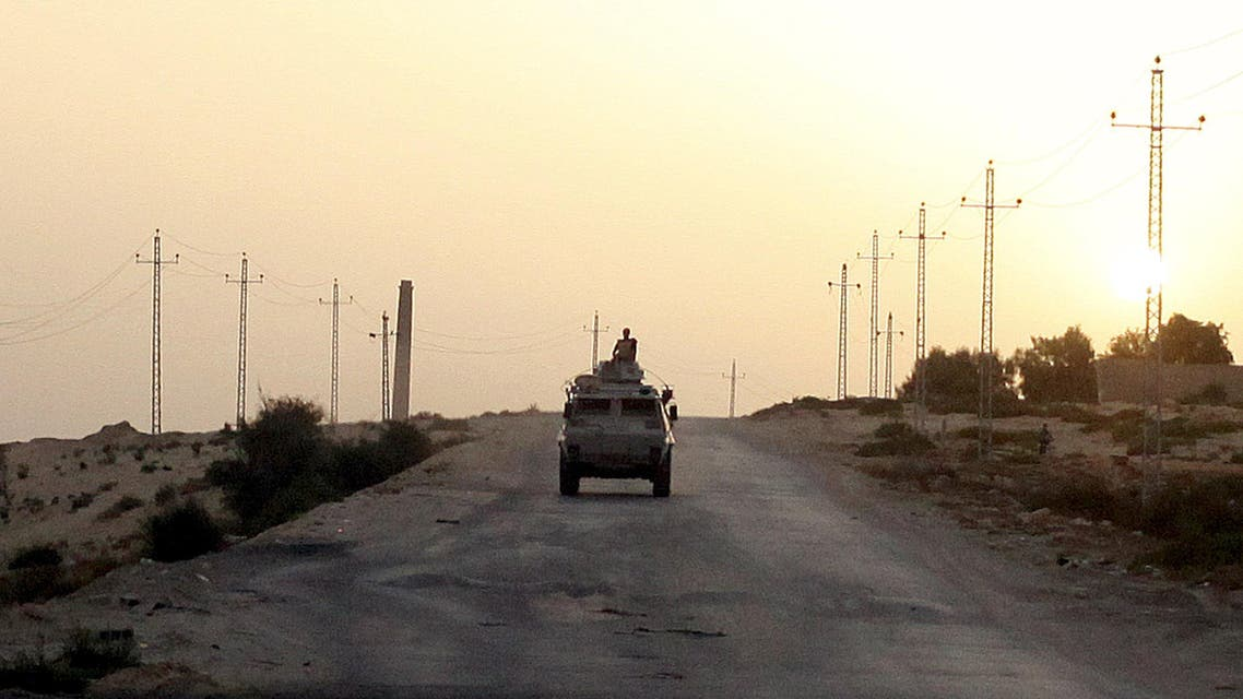 An Egyptian military vehicle is seen on the highway in northern Sinai, Egypt in this May 25, 2015 file photo. Reuters