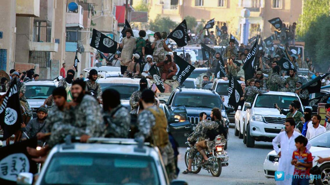 Fighters from the ISIS group parade in Raqqa, north Syria. (File: AP)