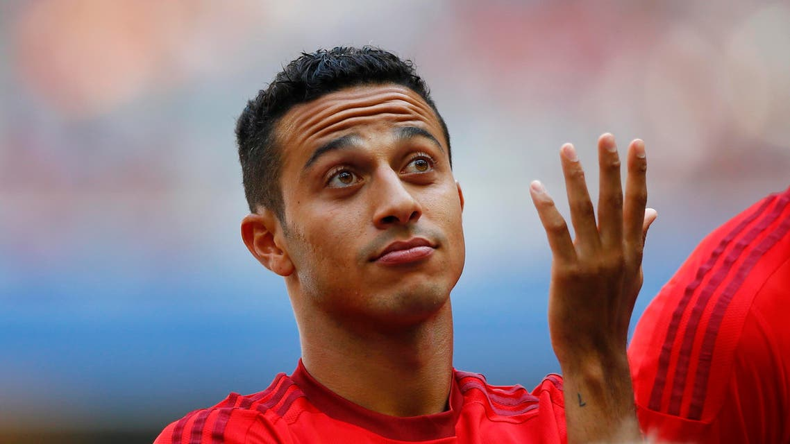 Bayern's Thiago from Spain gestures during a show training and team presentation for the upcoming German first division Bundesliga soccer season at the Allianz Arena in Munich, Germany, on Saturday, July 11, 2015. (AP Photo/Matthias Schrader)