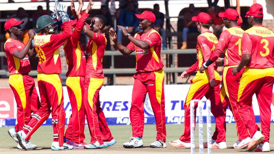 Zimbabwean players celebrate the wicket of Indian batsman Kedar Jadhav after he was caught behind during the One Day International between the two teams in Harare, Zimbabwe, Friday, July,10, 2015. (AP Photo/Tsvangirayi Mukwazhi)