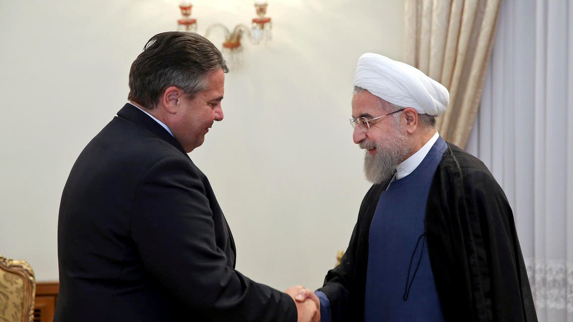 Iran's President Hassan Rouhani, right, shakes hands with the German Vice Chancellor and Economy Minister Sigmar Gabriel at the start of their meeting in Tehran, Iran, Monday, July 20, 2015. (AP)