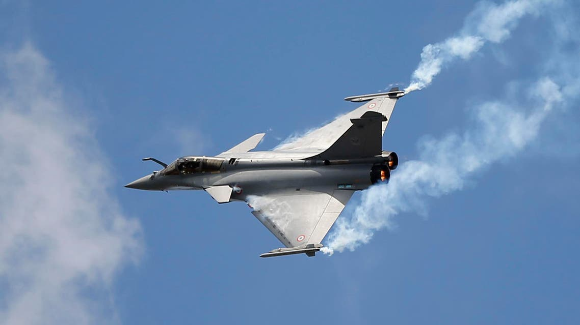 """French Capt. Benoit Planche, nicknamed """"Tao"""", performs with a Rafale single seat jet aircraft during its demonstration flight at the Paris Air Show, in Le Bourget airport, north of Paris, Friday, June 19, 2015. AP"""