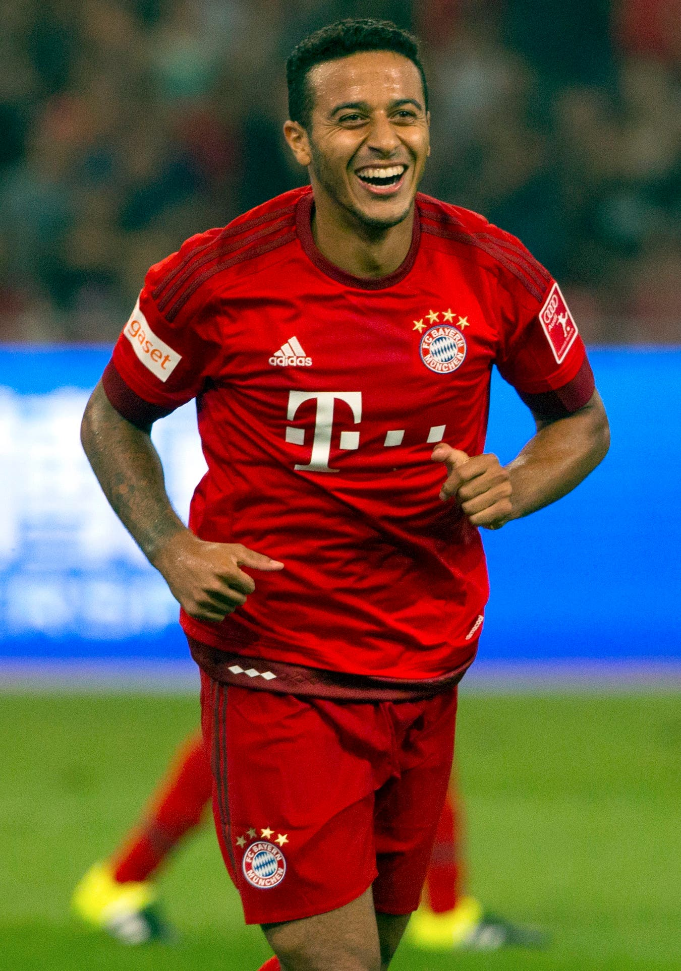 Bayern's Thiago cerebrates after scoring a goal in the second half of their friendly soccer match against Valencia in Beijing, Saturday, July 18, 2015. Bayern Munich beat Valencia, 4-1. (AP Photo/Mark Schiefelbein)