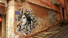 How Beirut's Banksy has brought color to the city's battered streets