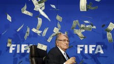 Showered in prankster's fake dollars, Blatter makes quick exit