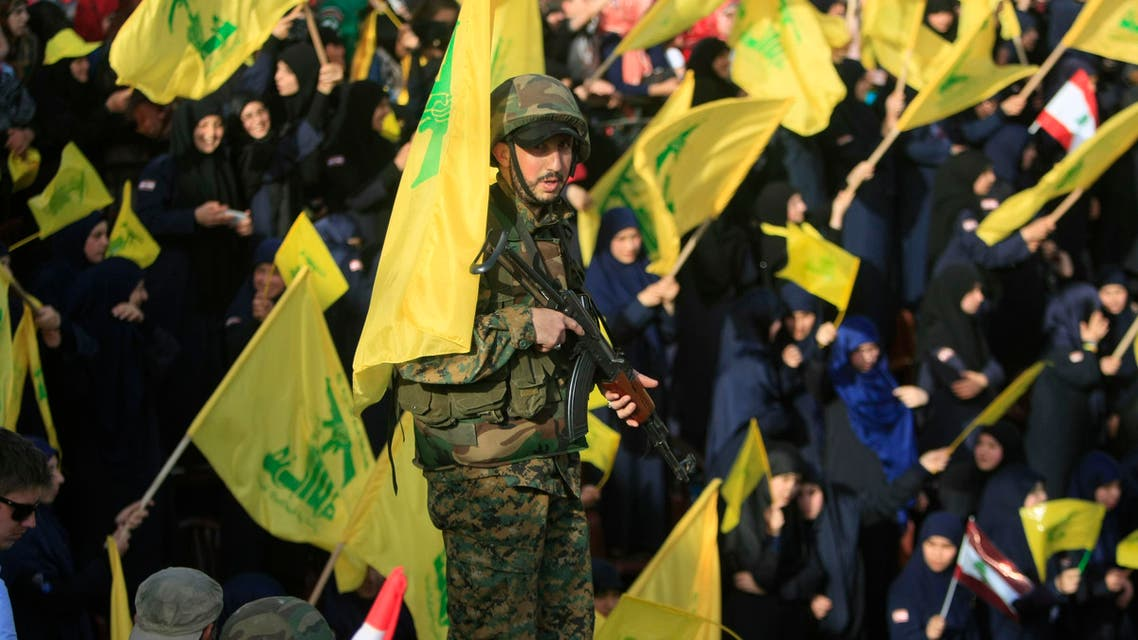 """A Hezbollah fighter stands guard during a rally commemorating """"Liberation Day,"""" which marks the withdrawal of the Israeli army from southern Lebanon in 2000. (File: AP)"""
