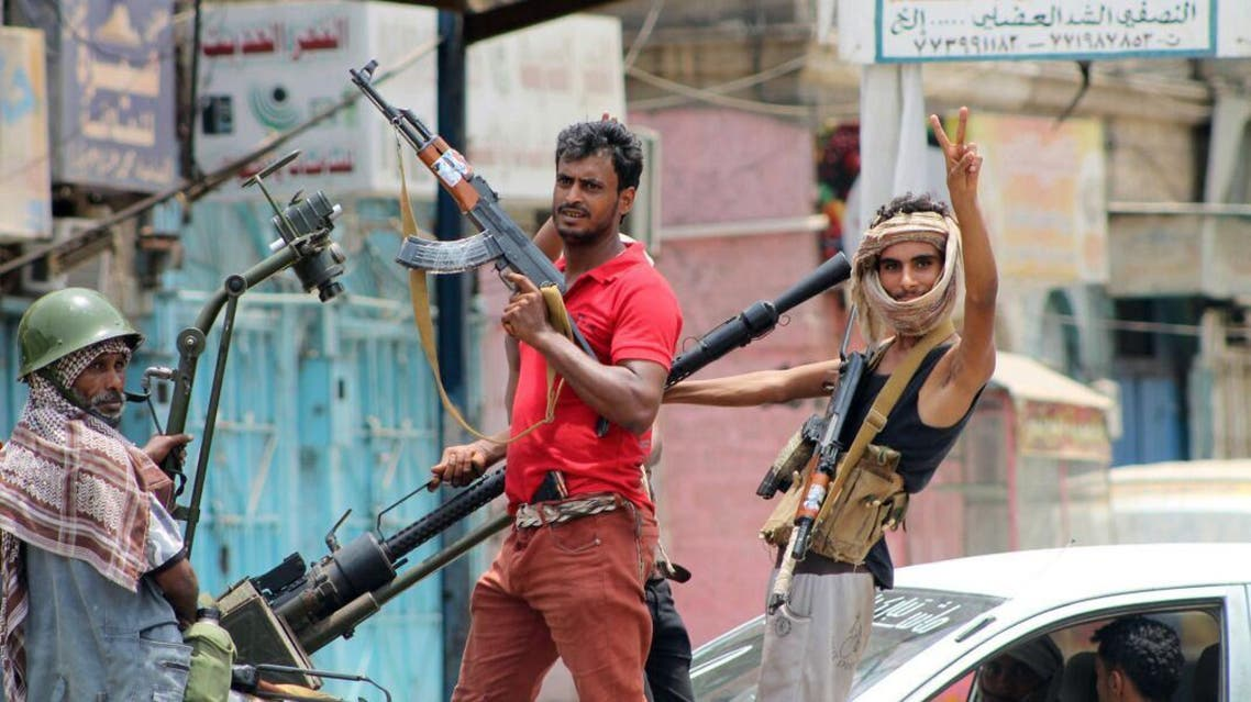 Fighters loyal to exiled President Abedrabbo Mansour Hadi, gesture as they drive through a street in the southern city of Aden on July 19, 2015.