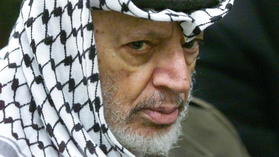 In this May 31, 2002 file photo photo Palestinian leader Yasser Arafat pauses during the weekly Muslim Friday prayers in his headquarters in the West Bank city of Ramallah. Yasser Arafat's body may be exhumed to allow for more testing of the causes of his death, the Palestinian president said Wednesday, July 4, 2012, after a Swiss lab said it found elevated levels of a radioactive isotope in belongings the Palestinian leader is said to have used in his final days. (AP Photo/Lefteris Pitarakis, File)