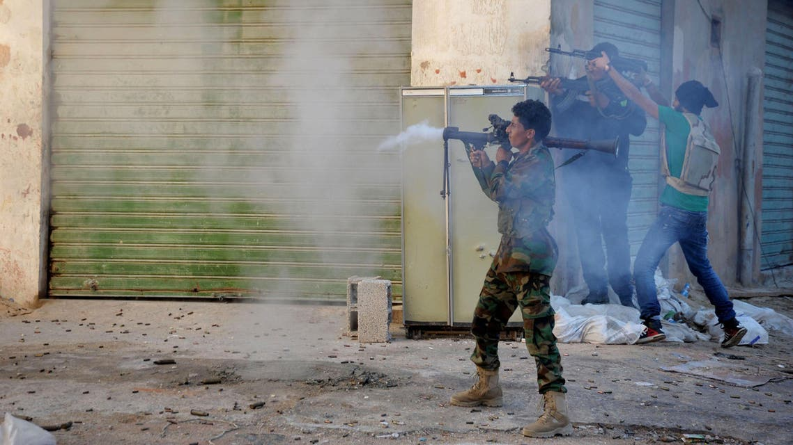 Libyan military soldiers fire their weapons during clashes with Islamic militias in Benghazi. Libya, virtually a failed state the past years, has provided a perfect opportunity for the Islamic State group to expand from its heartland of Syria and Iraq to establish a strategic stronghold close to European shores. (AP