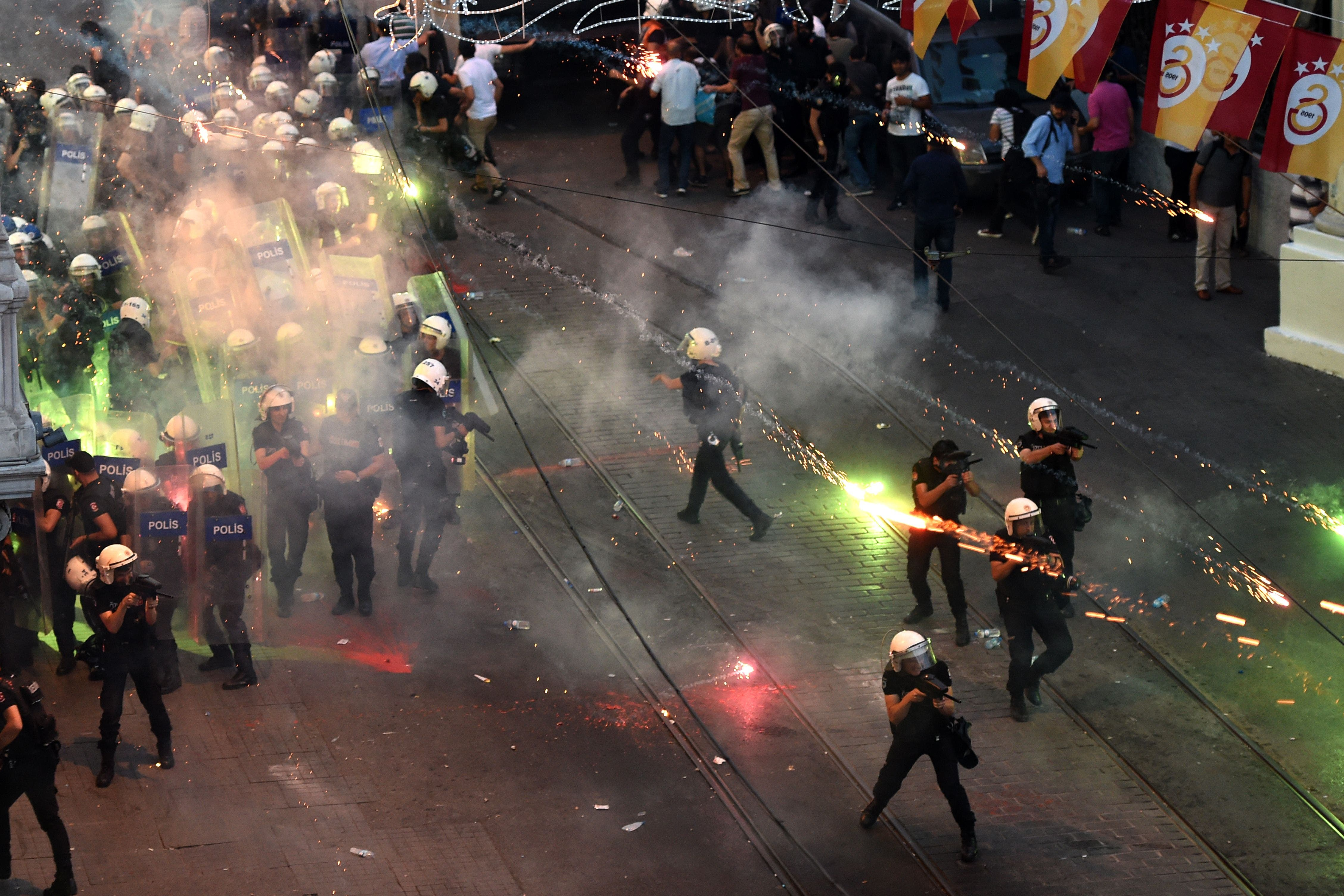 Protestors throw fireworks at Turkish riot policemen firing rubber bullets to disperse them during a demonstration on July 20,2015 in Istanbul  AFP