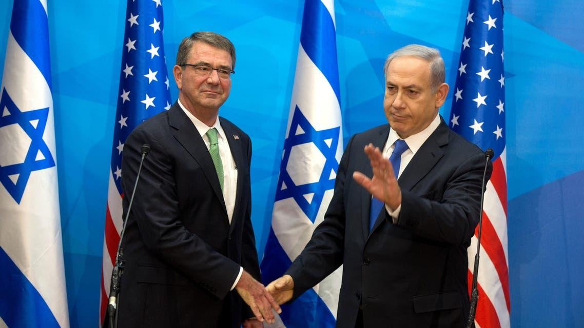 U.S. Defense Secretary Ash Carter, left, shakes hands with Israeli Prime Minister Benjamin Netanyahu ahead of their meeting in Jerusalem, Tuesday, July 21, 2015.