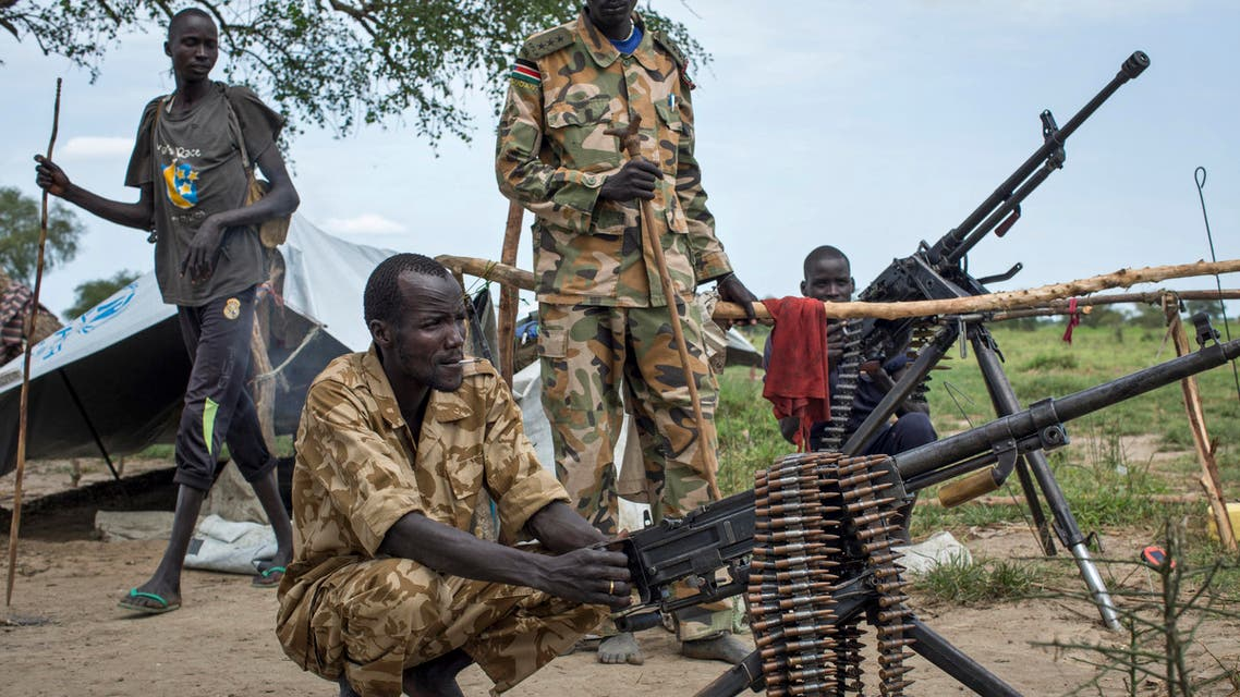 Rebel soldiers guard the village of Majieng, about 6km from the town of Bentiu, in South Sudan Saturday, Sept. 20, 2014. AP