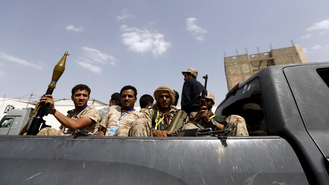Houthi fighters ride on the back of a patrol truck in Yemen's capital Sanaa. Reuters