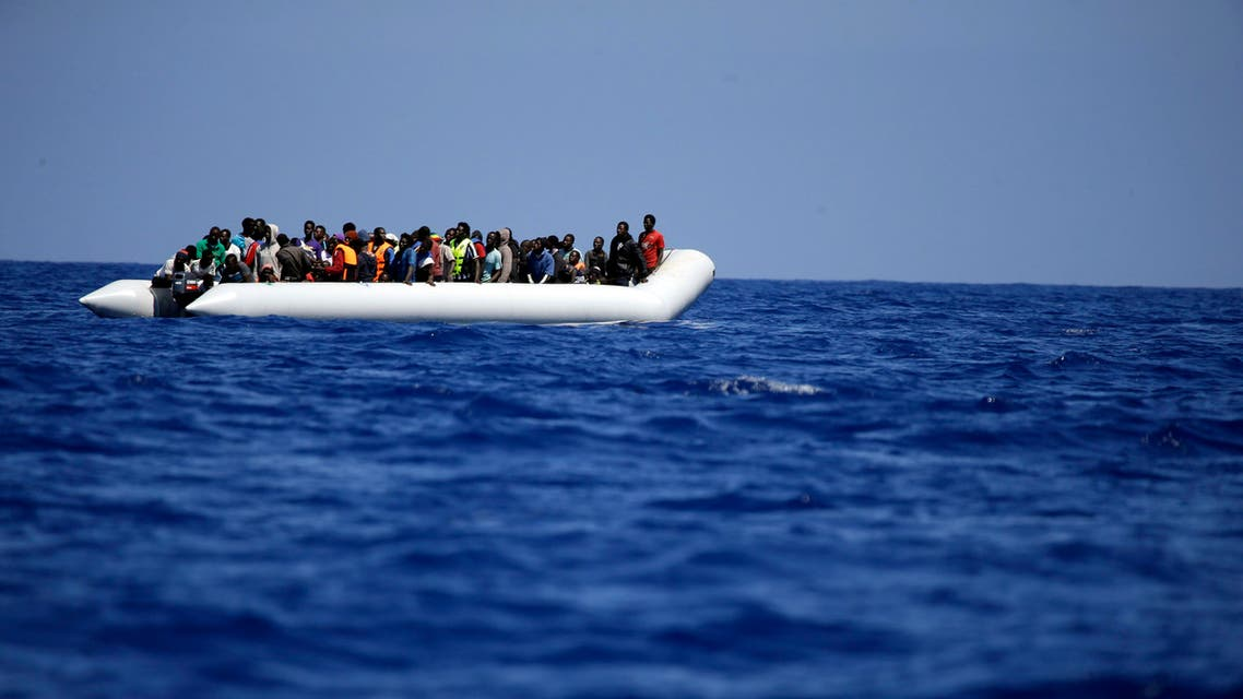 A rubber boat loaded of migrants is seen during a search and rescue mission in the mediterranean sea off the Libyan coasts, Italy, Tuesday, June 23, 2015. Hundreds of migrants were rescued on Tuesday by the Godetia Belgian Navy Vessel which is among a EU Navy Vessels fleet taking part in the Triton migrant rescue operations. (AP Photo/Gregorio Borgia)