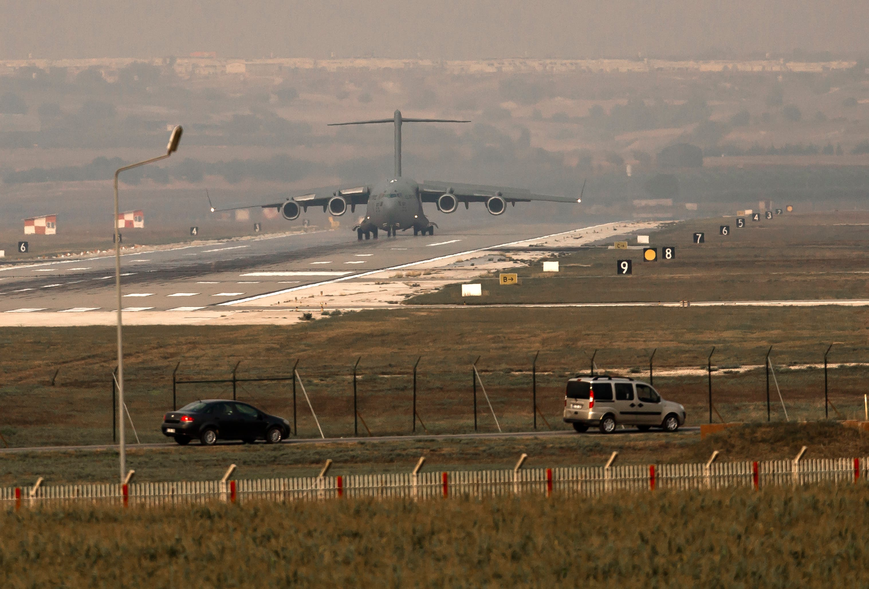 A US Airforce plane lands at the Incirlik airbase, southern Turkey, Saturday, Aug. 31, 2013. AP