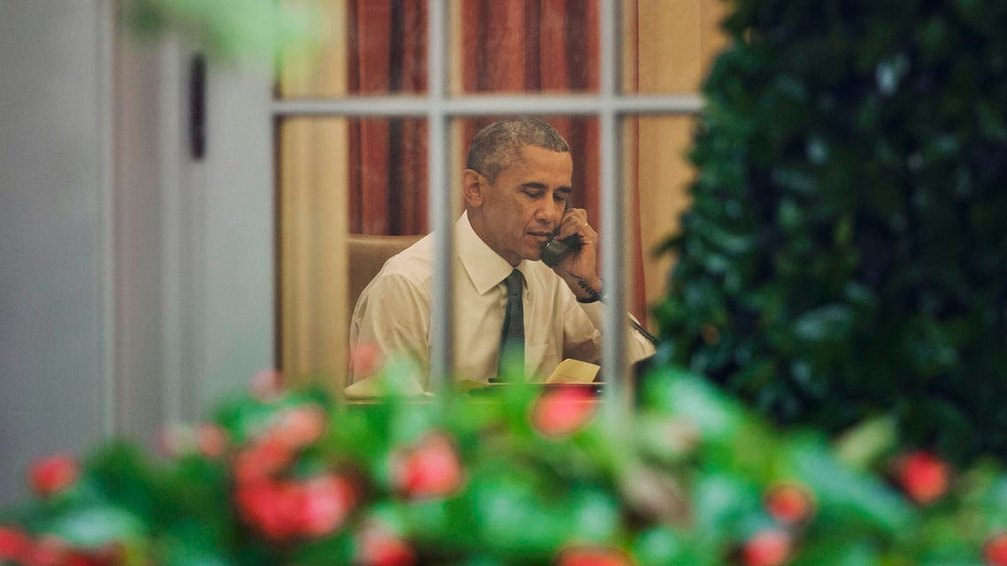 President Barack Obama is seen talking on the phone in the Oval Office of the White House in Washington, Friday, June 26, 2015. AP
