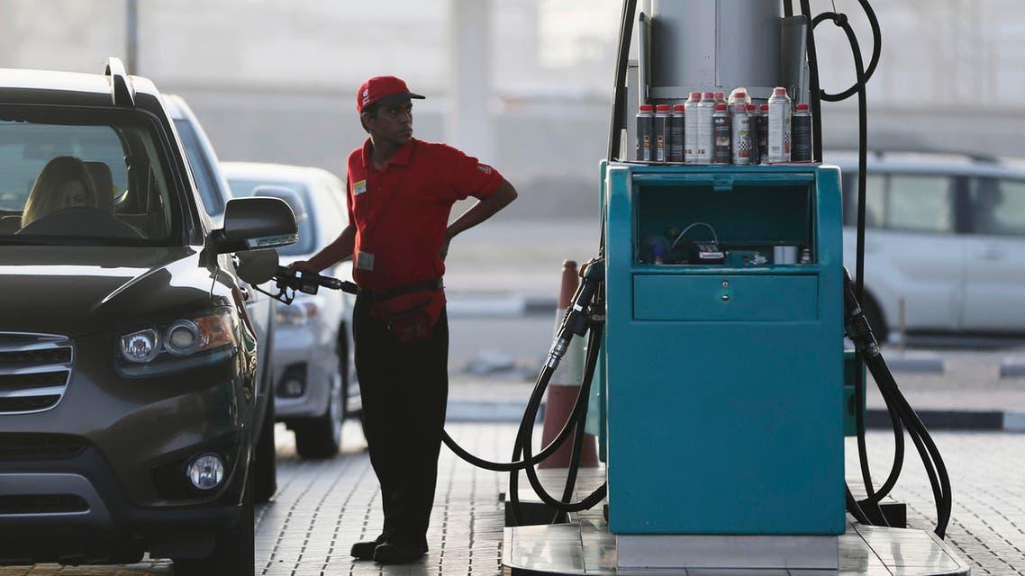 A petrol station staff member fills a gas tank on Wednesday, July 22, 2015, in Dubai, United Arab Emirates. (AP)