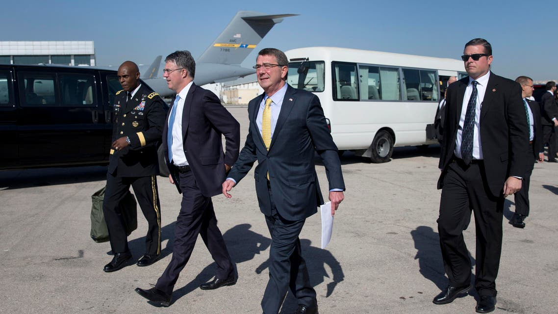 U.S. Defense Secretary Ash Carter walks along the tarmac with U.S. Army Lt. Gen. Ron Lewis, left, and Chief of Staff Eric Rosenbach, second from left, and members of his security team before boarding a E4-B military aircraft at Queen Alia Airport in Amman, Jordan, Wednesday, July 22, 2015. AP