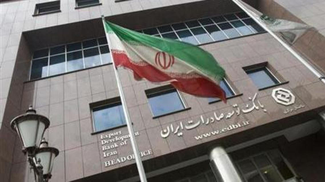 An Iranian flag flutters in front of the head office of the Export Development Bank of Iran (EDBI) in Tehran November 9, 2008.