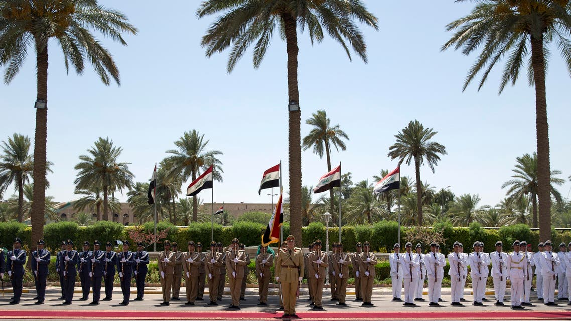 Carter in Baghdad, attends military exercise