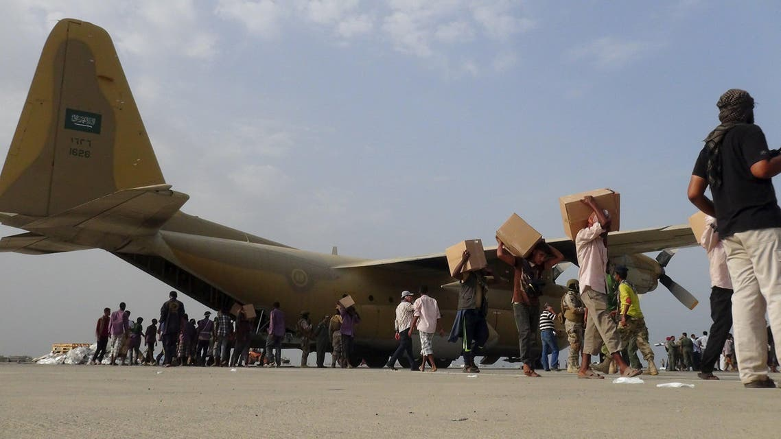 Workers unload aid shipment from a Saudi military cargo plane at the international airport of Yemen's southern port city of Aden July 23, 2015. (AP)