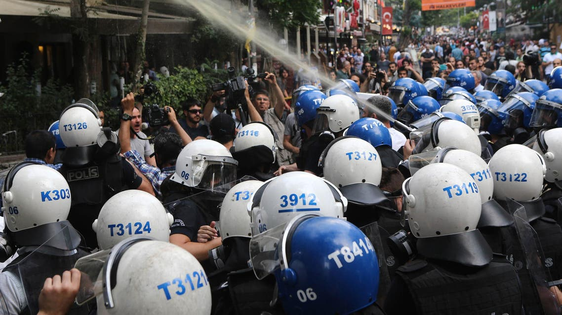 AA12 - Ankara, Ankara, TURKEY : Turkish police officers spray tear gas during a protest condemning a suicide bombing, that killed 32 activists on July 20 in the Turkish border town of Suruc, on July 25, 2015 in Ankara. Turkey's military on July 25 carried out a new wave of air and artillery strikes against Islamic State (IS) jihadists in Syria and Kurdish militants in northern Iraq, in an escalating campaign Ankara says is aimed at rooting out terror. The two-pronged operation against IS and the outlawed Kurdistan Workers Party (PKK) -- two groups who are themselves bitterly opposed -- came after a week of deadly violence in Turkey the authorities blamed on both organisations. Violence in Turkey erupted after the killing of 32 people in a suicide bombing on July 20 in the Turkish town of Suruc on the Syrian border carried out by a 20-year old Turkish man linked to IS. AFP PHOTO / ADEM ALTAN