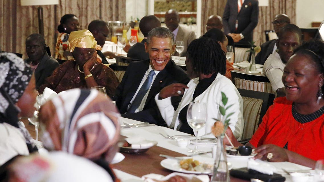 U.S. President Barack Obama attends a private dinner with family members at his hotel restaurant after arriving in Nairobi. (Reuters)